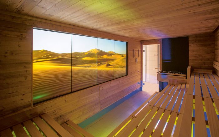 ATMOSPHERE by KLAFS: The specially glazed monitors are qualified for continuous use in sauna conditions and can perfectly reproduce the brilliant quality of the films.