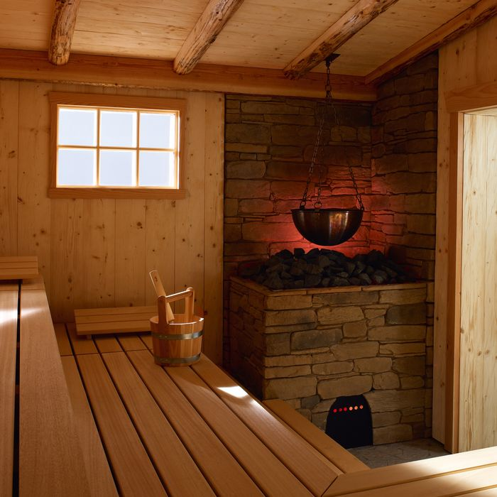 The rustic heater surround made of stone or artificial stone hides the robust heating technology behind our MAJUS sauna heater.